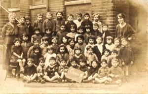 Dad holding sign at Robert Montefiore School c1925