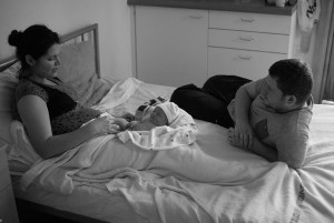 family on bed, isabel, kenneth and baby son